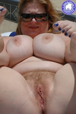 Big breasted redhead sunbathing by the p - XXX Dessert - Picture 12