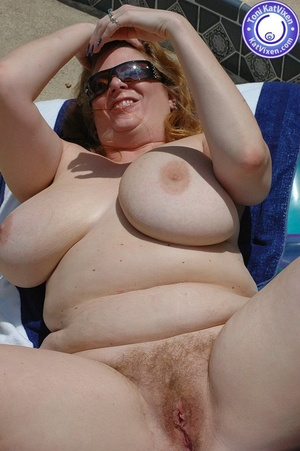 Big breasted redhead sunbathing by the p - XXX Dessert - Picture 14