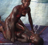 Naughty black tropical gals in G strings soiling each other with paints