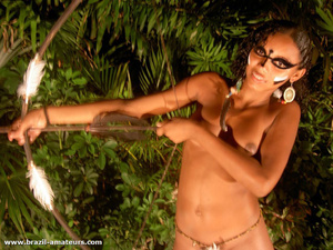 Seductive ebony girls in war paints and G strings stretching a bow preparing for hunting - XXXonXXX - Pic 3