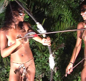 Two tropical babes with war paints on their faces dancing erotic dances