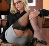 Sexy blonde Carli taking off her office suit to stay in her sexy stockings