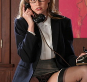 Sexy blonde secretary in glasses stripping in her boss's office to wait