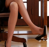Very hot blonde secretary in sexy stockings and lingerie enjoys posing
