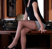 Brunette secretary girl laying on the boss's desk topless in her stockings