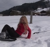 Busty teen blonde in a ski equipment exposing her naked tits in the snow