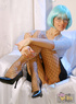 Dirty mom in a blue wig posing on cam in fishnet pantyhose presenting