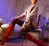 Naughty mom in a red cap, high boots and stockings suspended with braces