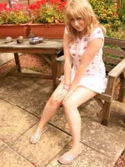 Blonde chubby teen in a lovely dress pressing berries - Picture 1