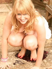 Blonde chubby teen in a lovely dress pressing berries - Picture 10