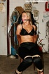 Blonde chick with a gag-ball and bound to the chair gets her tits pinched