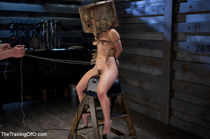 Poor girl with a wodden box with hole on her head sitiing on a fucking machine when master caning her heels - XXXonXXX - Pic 12