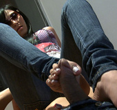 Nasty fully dressed chick in sunglasses giving a footjob to a dude in