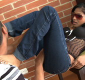 Hot Asian chick in jeans and sunglasses giving an awesome footjob to a