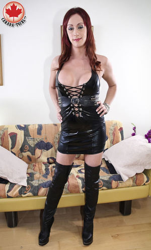 Slutty ginger ladyboy in a black latex d - XXX Dessert - Picture 1