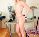Dirty blonde tranny in a jeans skirt and transparent top gets naked to