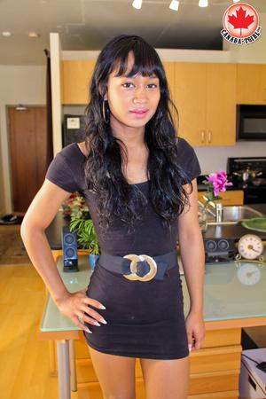 Swarthy Asian T-girl in a black dress an - XXX Dessert - Picture 2