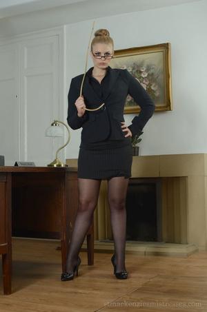 Female blonde in black dress stripping