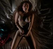 Lovely brunette girl in a beige panties rubbing her slit under them