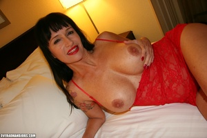 Busty brunette in a red dress is happy t - XXX Dessert - Picture 2