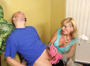 blonde mom giving handjob