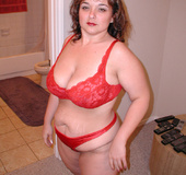 Chubby blonde milf in a red lingerie swallows a stiff rod