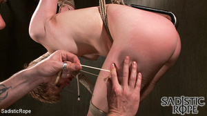 Short-haired bound babe with plastic bag - XXX Dessert - Picture 4