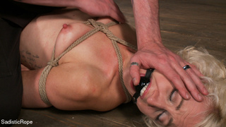 small-titted girl roped suspended