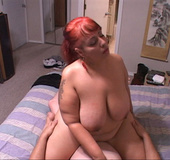 Ponytailed red MILF gets assfucked