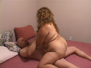 curly bbw rides cock