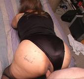 Fat latina granny in stockings opens her back door