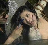 Masochist Asian bitch bound to huge wheel tortured in water