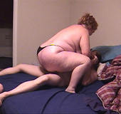Ponytailed granny in black panties sucks cock