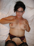 Latina mom in glasses and stockings