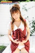 Red Japanese girl in funny red dress and boots posing without panties