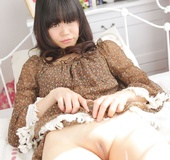 Shameless Japanese teen in brown blouse lifts her legs up to show her