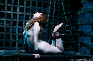 Red naked girl in feet and hands cuffs a - XXX Dessert - Picture 1