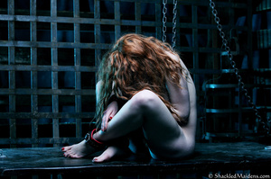 Red naked girl in feet and hands cuffs a - XXX Dessert - Picture 4