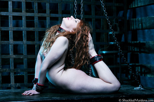 Red naked girl in feet and hands cuffs a - XXX Dessert - Picture 6