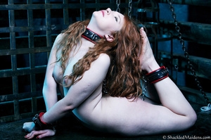 Red naked girl in feet and hands cuffs a - XXX Dessert - Picture 8