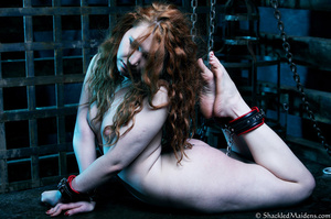 Red naked girl in feet and hands cuffs a - XXX Dessert - Picture 10