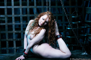 Red naked girl in feet and hands cuffs a - XXX Dessert - Picture 11