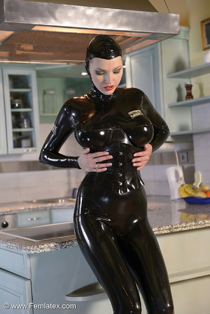 Tall blond babe in black latex and boot  - XXX Dessert - Picture 2