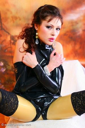 Flexible brunette latex babe shows her a - XXX Dessert - Picture 9