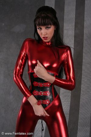 Seductive brunette babe in red latex jum - XXX Dessert - Picture 1