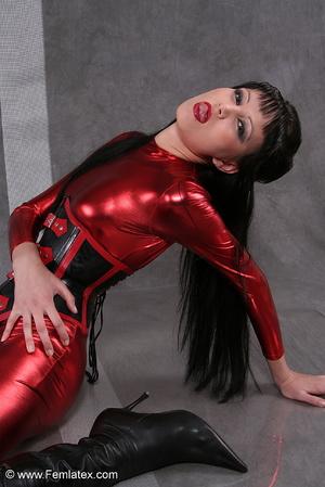 Seductive brunette babe in red latex jum - XXX Dessert - Picture 3