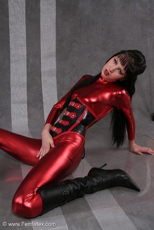 Seductive brunette babe in red latex jum - XXX Dessert - Picture 4