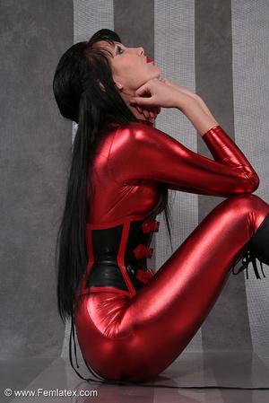 Seductive brunette babe in red latex jum - XXX Dessert - Picture 6