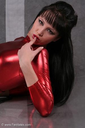 Seductive brunette babe in red latex jum - XXX Dessert - Picture 10