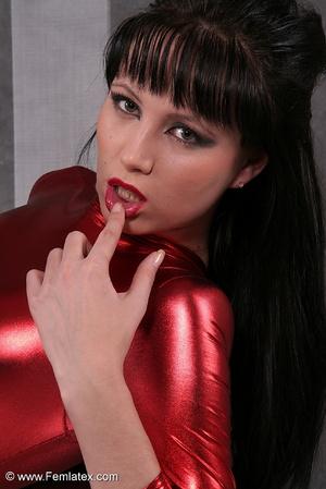 Seductive brunette babe in red latex jum - XXX Dessert - Picture 11